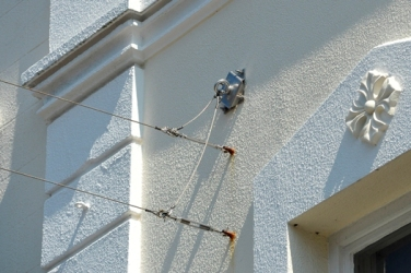 Stainless steel ancho plate for catenary system installed in wall