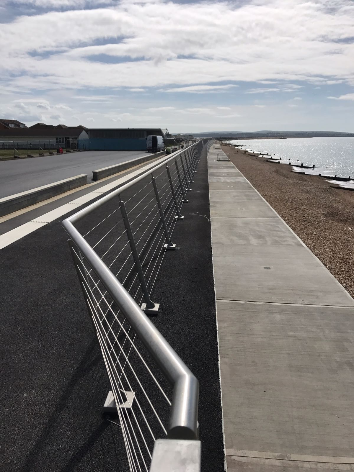 Horizontal stainless steel balustrade at seafront